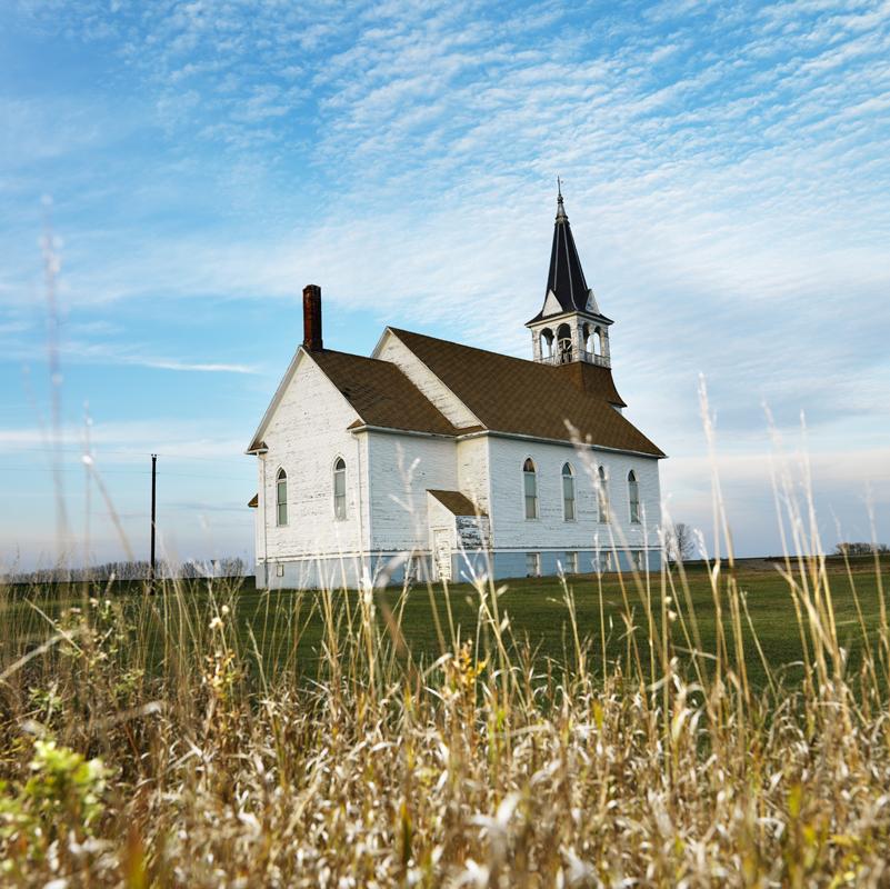 Rural church in field.