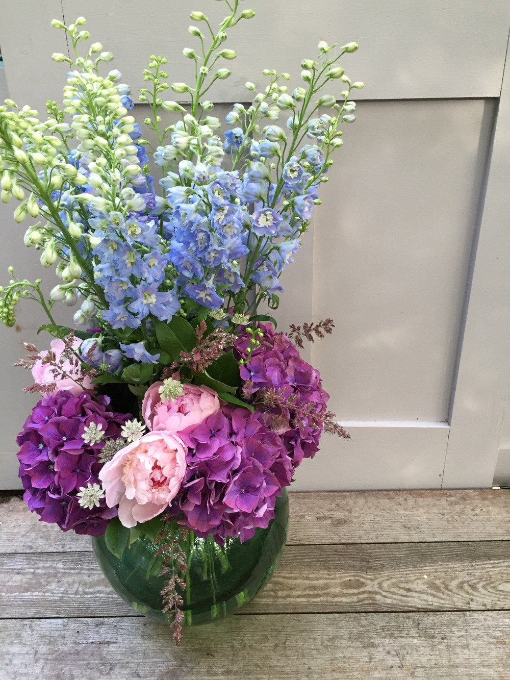 Delphiniums, hydrangea, peonies, astrantia and grasses.