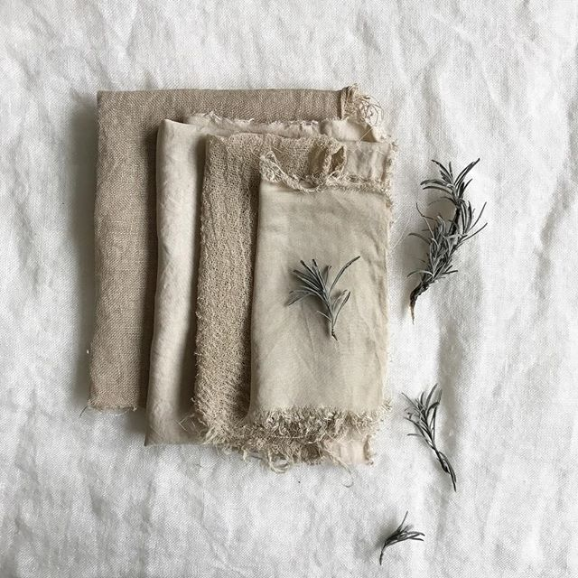 This is the mysterious colour that I made from lavender stems a few days ago. It's a lovely greeny/grey shade. I'll be cutting up some of these pieces for my quilt 🌿 . The darker fabric on the left is linen, the slightly more textured fabric is organic cotton gauze, and the fabric with a sheen is bamboo silk. They were all pretreated with soya milk and dyed as per the slow method in my book Botanical Colour at your Fingertips. . The different fibres take the dye differently for sure, but the shimmery texture of the bamboo makes it look even brighter as it gleams in the light. I love comparing textures side by side like this. I need to incorporate different textures into the next section of my quilt ✨ . It's quite different from the grey that I've made from lavender stems in the past. There are lots of different types of lavender and no doubt they all make different shades. This is the fun part, right? The excitement of discovering a new colour... . Are you dyeing, stitching or crafting anything on this Sunday? 💚