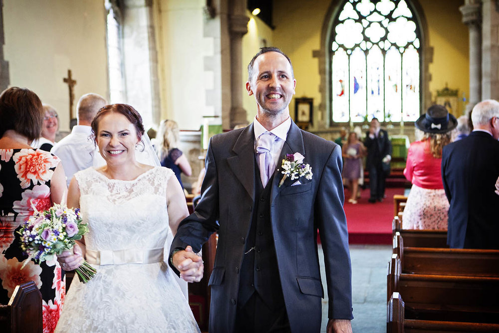 "sally & Mark - ""We had met a few photographers before we came across Clive but none of them showed us what we were after. As soon as we saw Clive's portfolio and talked with him we knew instantly we'd found our man. On the day he was practically invisible working away in the background and the results were stunning. His eye for taking striking images that were natural and spur of the moment is extraordinary. There were so many magic moments during our day, Clive seemed to capture them all, including the small ones at the time you'd think were insignificant. We have had wallpaper made with a montage of all our wedding photographs as they are that good and we can relive our special day through Clive's work every single day. It is important to get the right wedding photographer and without a doubt, for us that was Clive"""