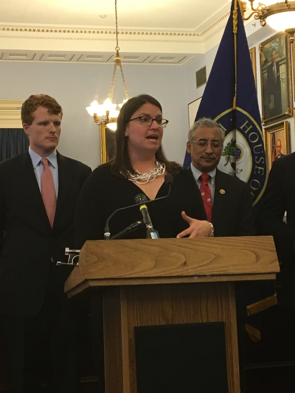 AU Legislative Director Maggie Garrett speaks at a press conference unveiling the Do No Harm Act flanked by Reps. Kennedy (l) and Scott.