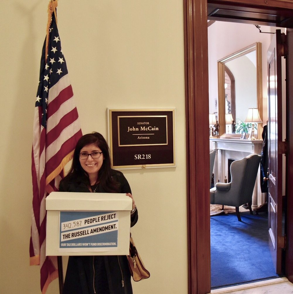 Americans United's Legislative Assistant Samanatha Sokol delivering petitions.