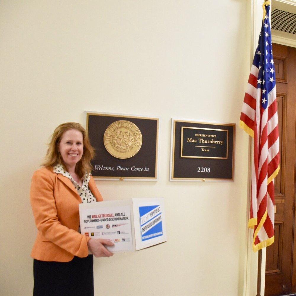 Americans United's Legislative Assistant Director Dena Sher delivering petitions.