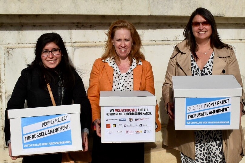 Americans United's Legislative Assistant Samantha Sokol, Assistant Legislative Director Dena Sher, and Legislative Director Maggie Garrett deliver #RejectRussell petitions to Congress.