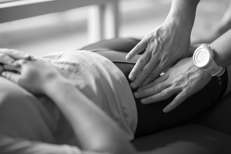 Shown above: Soft tissue massage to tensor fasciae latae (TFL).
