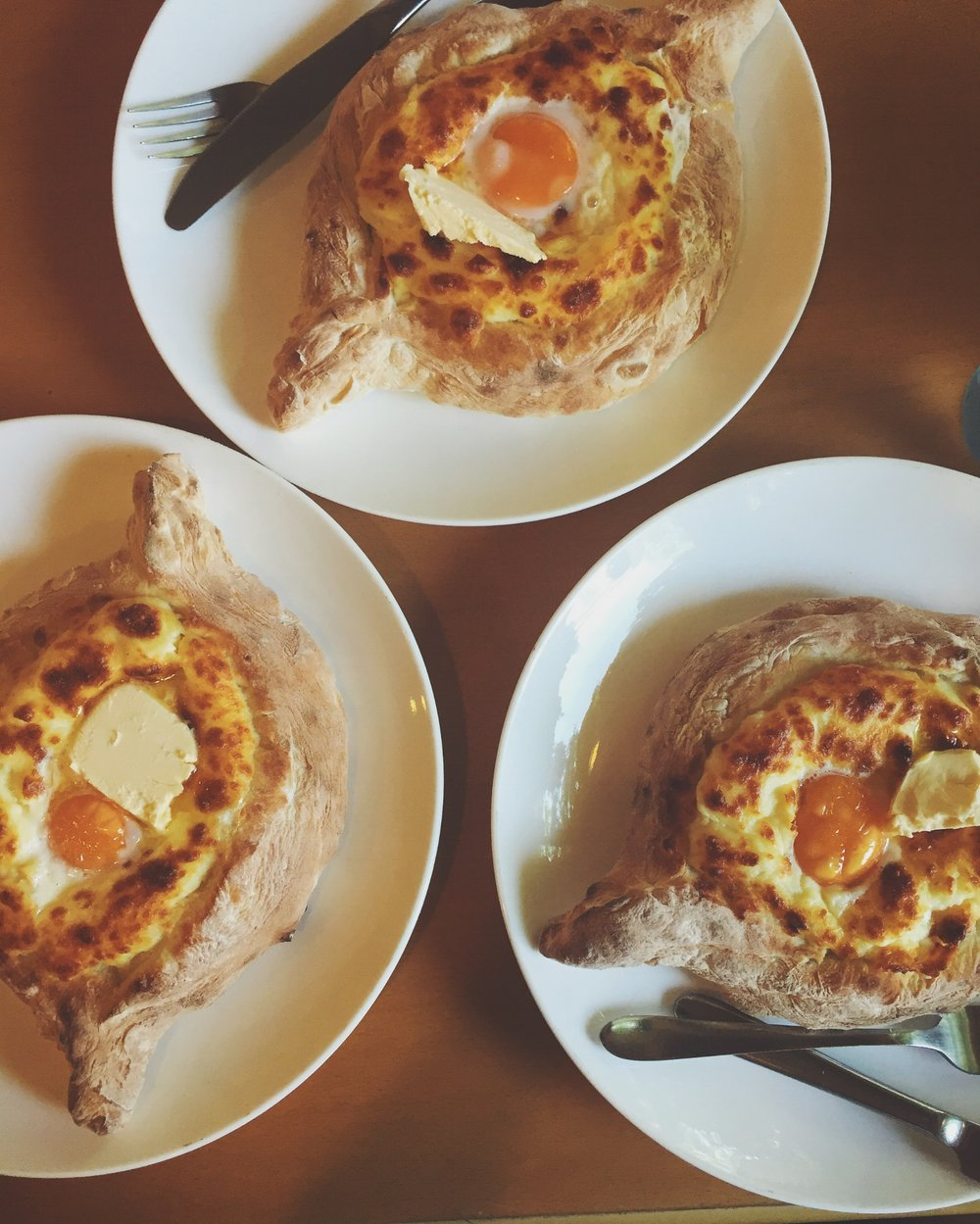 A trio of khachapuri at a Tbilisi parlor devoted to the dish in July 2015.