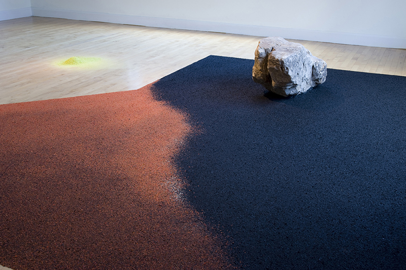 """In A Landscape Anew, 2012 / Hudgens Arts Center, Atlanta, GA Hand-shredded Flower Petals, Stone, Mirrors, Turf, Projection, 180 """" x 600 """" x 192 """" (Exhibition View)"""