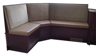 Astoria   Designer Restaurant Booth    The Astoria Booth has rich woods and fabrics and endless options.  T  he Astoria is the ideal piece to customize for your bar.   Shown In: Grey Leather & Dark Walnut Finish   Dimensions:   L: 60″ x 60″  D: 26″  H: 36″   Available in custom sizes & fabrics.