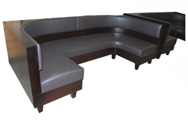 Barnett Designer Banquette Displayed In: Grey Vinyl & Walnut Finish Dimensions: L: 48″ X 96″ X 48″ D: 26″ H: 36″ Custom sizes & fabrics are always available. A cozy and sophisticated statement is created by the addition of tapered wood legs. Customize for your casual comfortable restaurant!