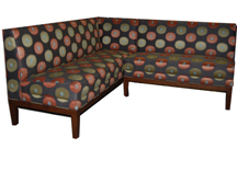 Jeannie Designer Banquette Displayed In: Mokum Walnut Wood Finish Dimensions: W: 72″ x 76″ D: 26″ H: 34″ Available in custom sizes & fabrics. Jeannie is a real show stealer with lots of vibrant personality. Tapered legs and a thick upholstered seat with welt-detail will attract the right kind of attention in your dining establishment.