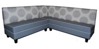 Kaleidescope Designer Banquette Displayed In: Gray Vinyl with Custom Fabric Back Dimensions: L: 76″ X 60″ D: 26″ H: 36″ Available in custom sizes & fabrics. Kaleidoscope will makes its mark in your restaurant with this sunburst patterned.  The contrasting piping adds special detailing that's striking and elevate this banquette into high style.