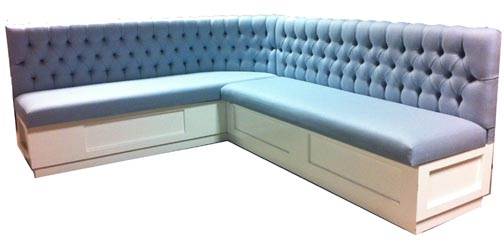 Jodee Designer Banquette Displayed In: Blue Wood Blend Fabric and Painted Base Dimensions: 77″ x 93″ (customizable) D: 26″ H: 36″ Available in custom sizes & fabrics. This designer banquette features a luxurious diamond tufted back and a painted base.   The piece will compliment nice restaurant china and crisp linens!