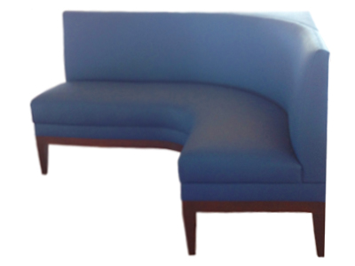 Roberta Designer Banquette As Displayed: Forsythia Blue With Wooden Legs Dimensions: W: 60″ x 48″(customizable) D: 24″ H: 34″ Available in custom sizes & fabrics. The sophisticated custom banquette is designed to fit perfectly into the corner of your restaurant's dining room creating a luxurious space-saving nook-seat..  This modified restaurant-booth has been transformed with a sophisticated wood border and tapered legs custom-stained your desired color.