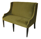 Savoy Designer Banquette As Displayed: Olive Velvet Dimensions: L: 50″ D: 31″ H: 43″ Available in custom sizes & fabrics. The Savoy's custom wing-back design trimmed in nail-heads illustrates its detailed craftsmanship. Long tapered legs heighten it tradtitional appearance.