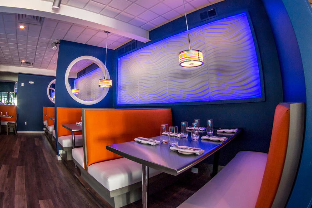 CUSTOM DESIGNED BOOTHS & 3D WALL TREATMENT