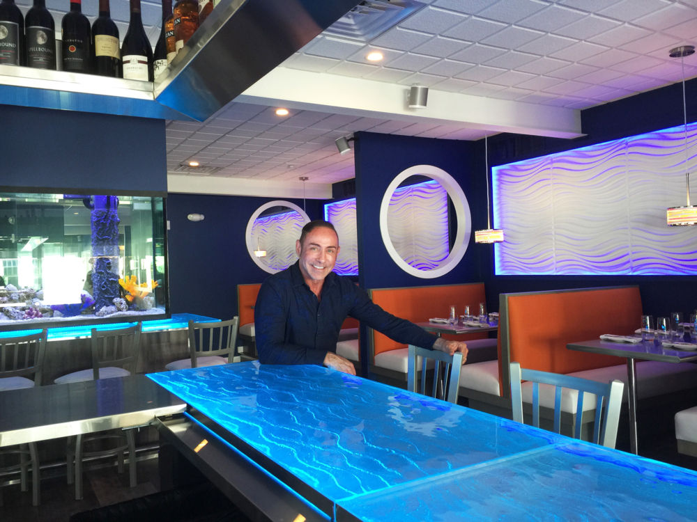 Raymond Haldeman in Fins, Cape May, NJ enjoying his restaurant design.