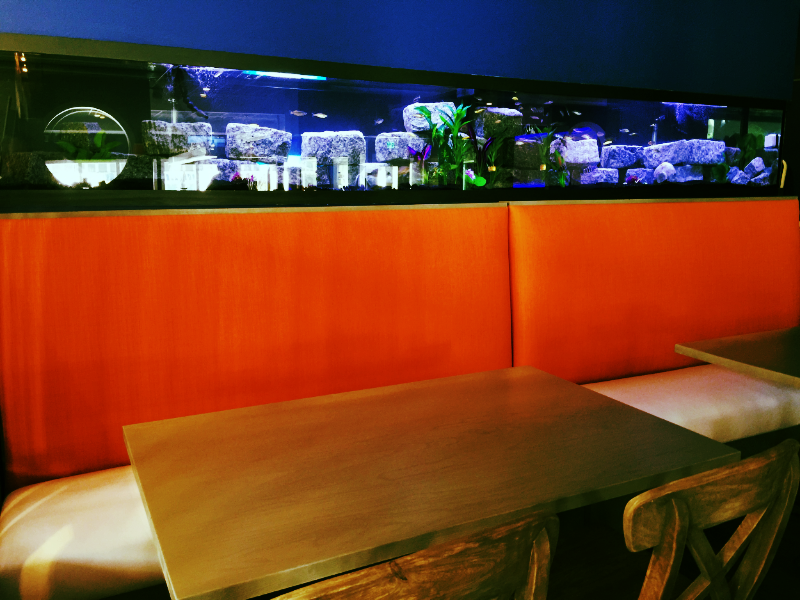"""After"" A 14' long aquarium above the carrot tweed banquette designed by Raymond Haldeman, the Restaurant Designer."