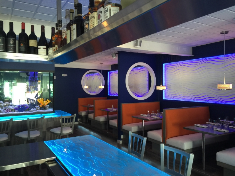 """After"" New custom designed booths, SS tables, infinity portholes and 3D wave design created by restaurant designer Raymond"