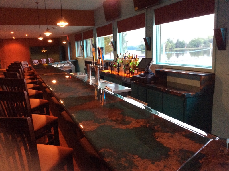A glistening Patina Copper Bar Top replaced the existing laminate top/