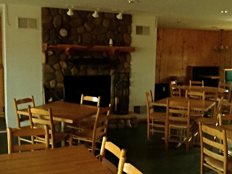 """""""Before"""" The old stone fireplace and ladder back chairs."""