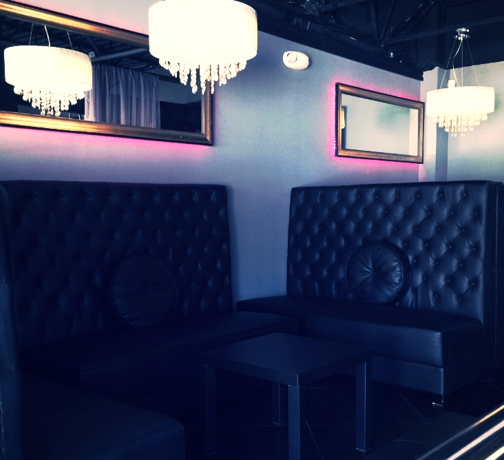 """""""After"""" High-Back tufted leather banquettes created individual VIP seating areas"""