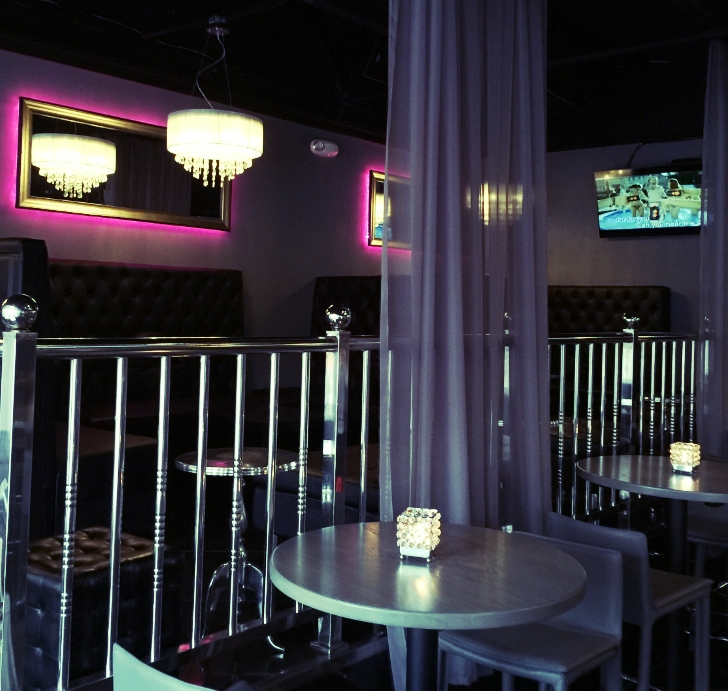 """After"" The restaurant designer added LED back-lit mirrors that cast a Fuchsia glow onto the soft dove-gray walls"
