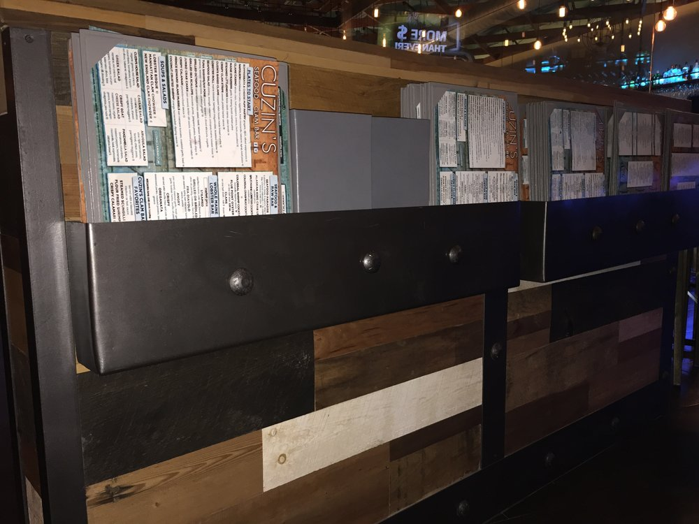 Menus Stored in Steel Riveted Holders on Reclaimed Barn Wood Knee-wall supporting Glass Partition
