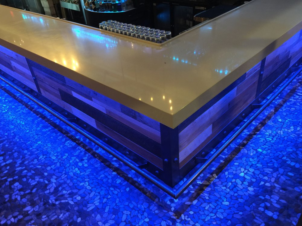 LED illuminated River Rock Floor Inset around Bar perimeter