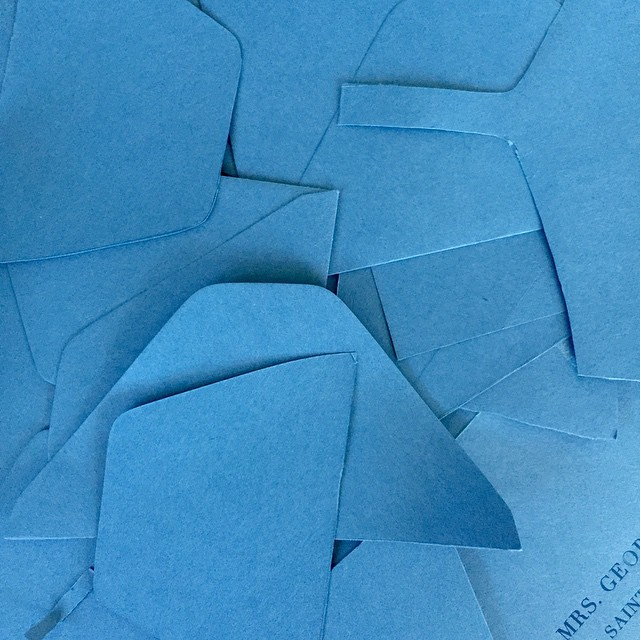 The wedding invite rush has begun, which means makeready scraps everywhere! Pretty blue, eh?  #letterpress #printing #blue #envelopes #wedding #weddinginvitation