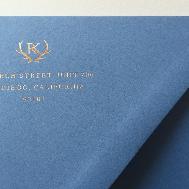 Rose gold foil on blue envelopes. Yes please.  #letterpress #goldfoil #wedding #weddinginvitation #Montana #montanawedding #montanabride