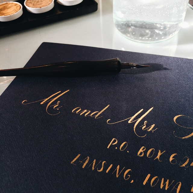 So excited to be calligraphing the envelopes for this incredibly bespoke wedding suite we just finished.  I WISH I could show you more, but you'll just have to wait! #gold #calligraphy #wedding #weddinginvitation #montanabride #montanawedding