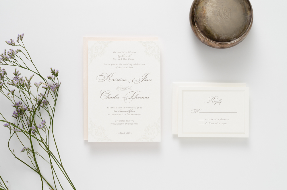 Classic, elegant, feminine letterpress wedding invitation suite with traditional ornamental accents