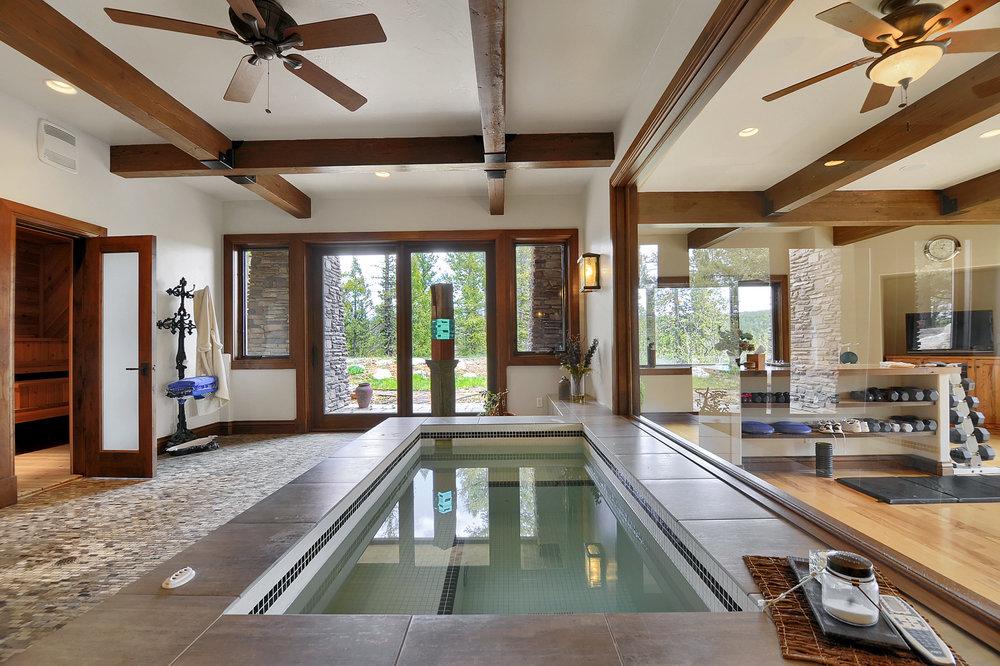 16 - Spa with view window to exercise room. Door to sauna on left.jpg