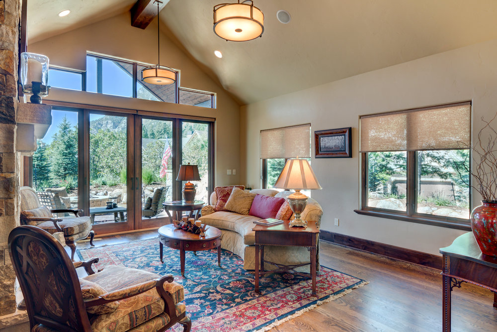 7 - Living Room Opens to Patio with Mountain Views.jpg
