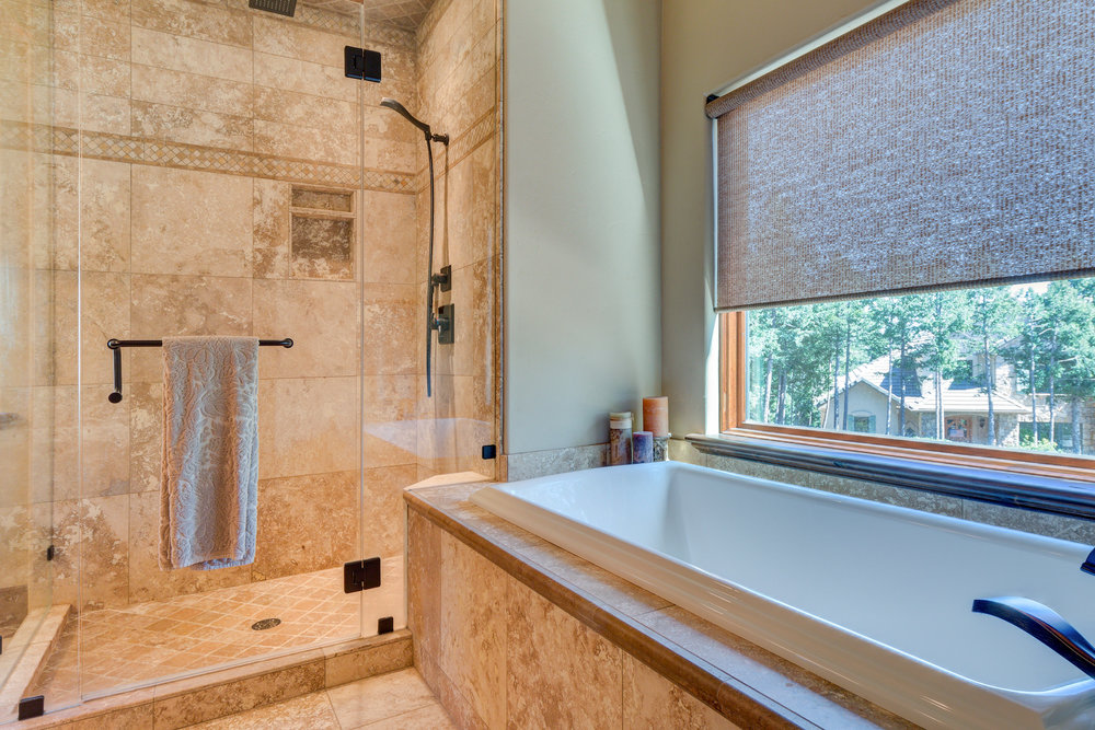 21 - Master Bath has Large Soaking Tub + Big Travertine Shower.jpg