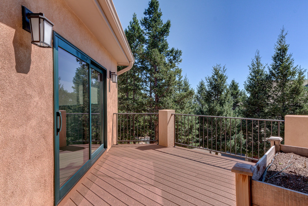 30 - Back Deck is Accessed From Kitchen and Master.jpg