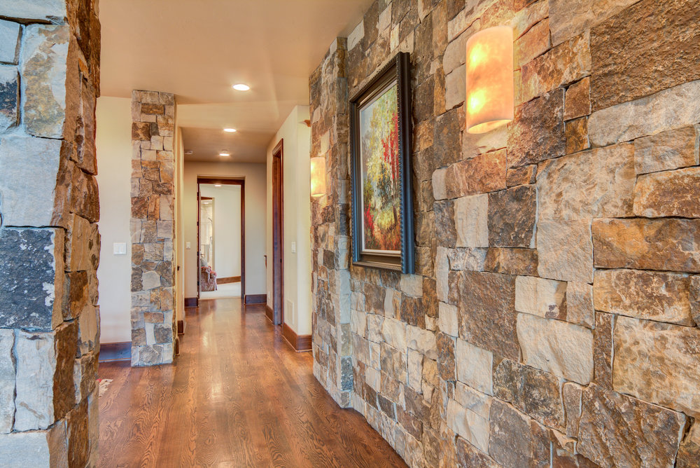 Rock Wall_Hallway that leads to powder room and master bedroom.jpg