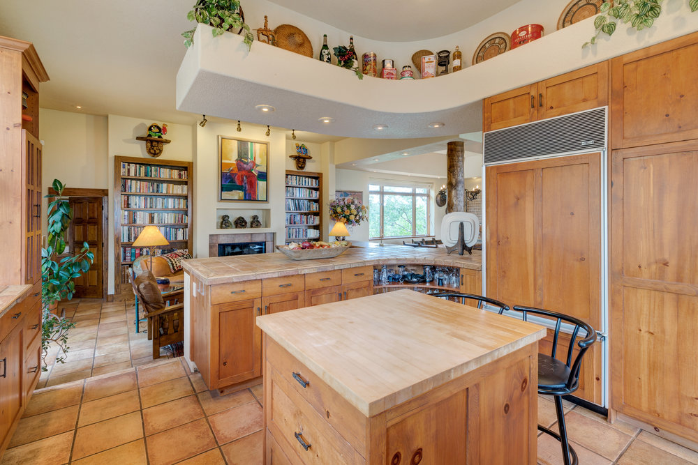 17-Kitchen overlooks hearth room.jpg