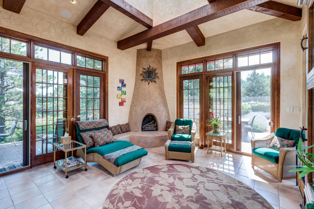 11-Off the kitchen the sunroom family room has 12ft beamed ceiling with skylight and 3 sets of sliding french doors to outdoor patios.jpg
