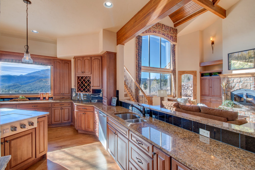 10-Kitchen opens to Great Room and has great views through the big view window.jpg