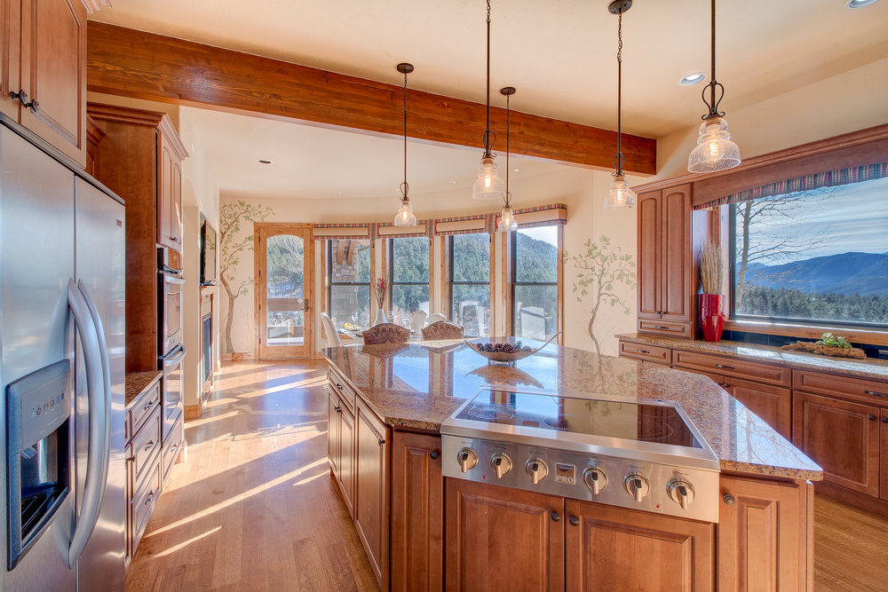 13-Kitchen opens to hearth room.jpg