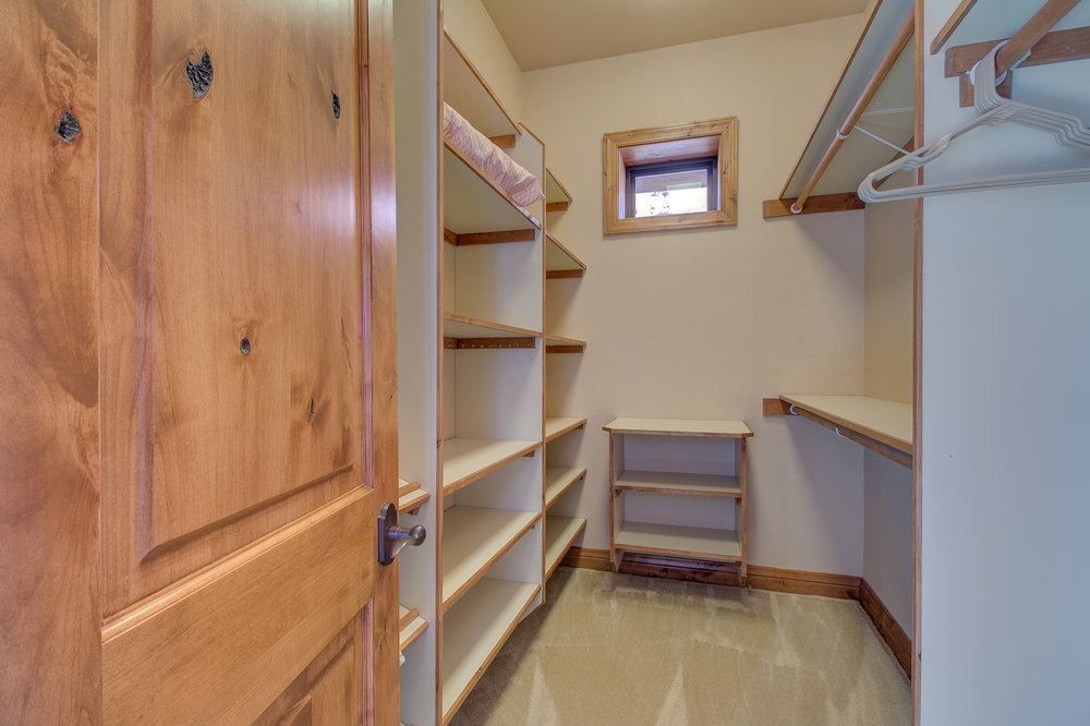 21-One of two walk in closets in the master suite.jpg