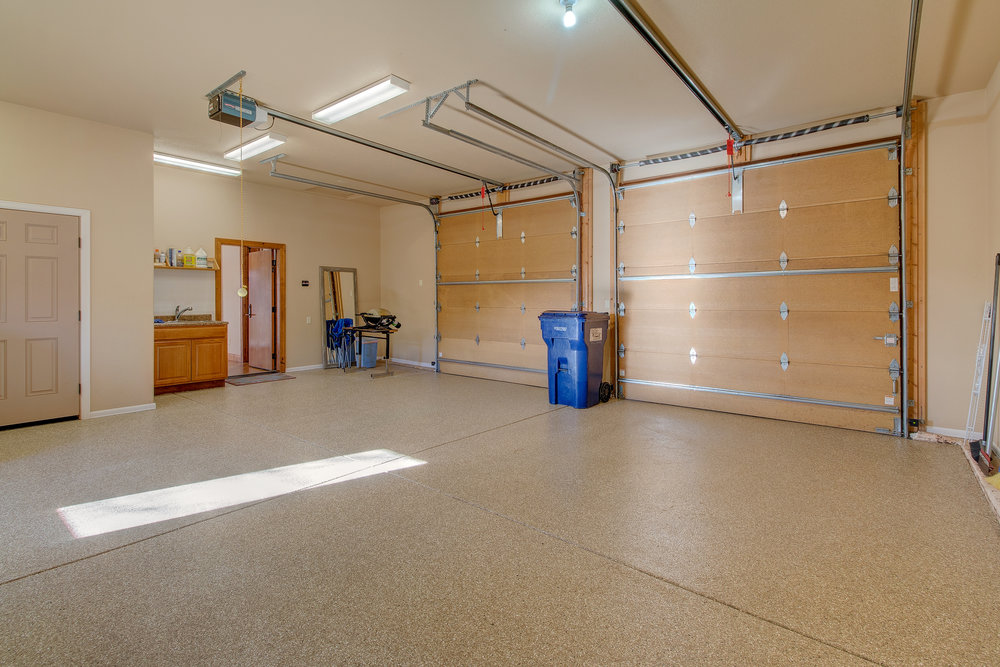31-One of the 2 heated garages, this one with new epoxy floors.jpg
