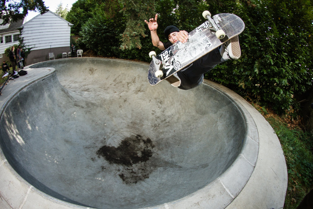Ryan blasting frontside with a subtle punk rock hand gesture \m/ -