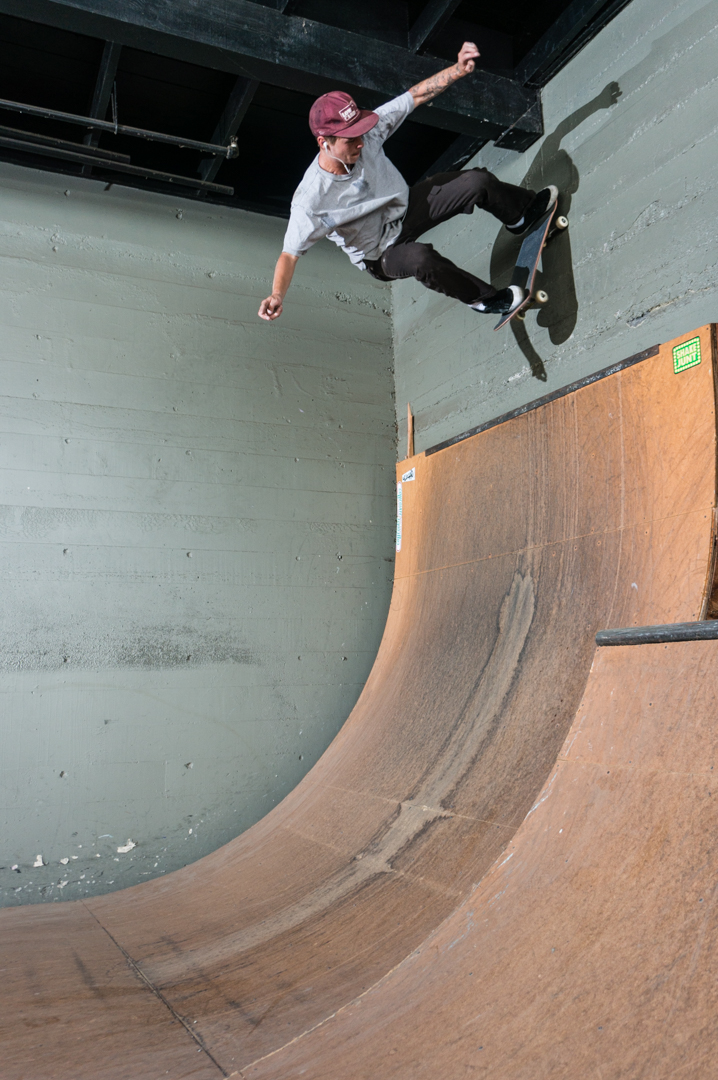Got to skate the ramp behind Tactics for a bit. Here's Jah fakie thrusting four wheels up on the wall and poppin back in. Probably listening to Waylon -