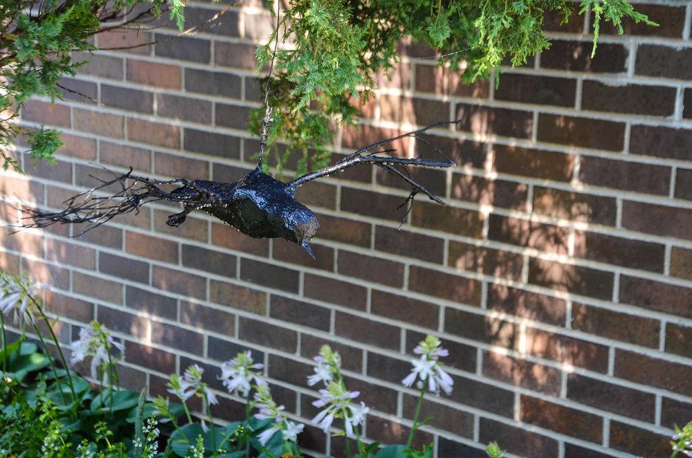 black bird sculpture
