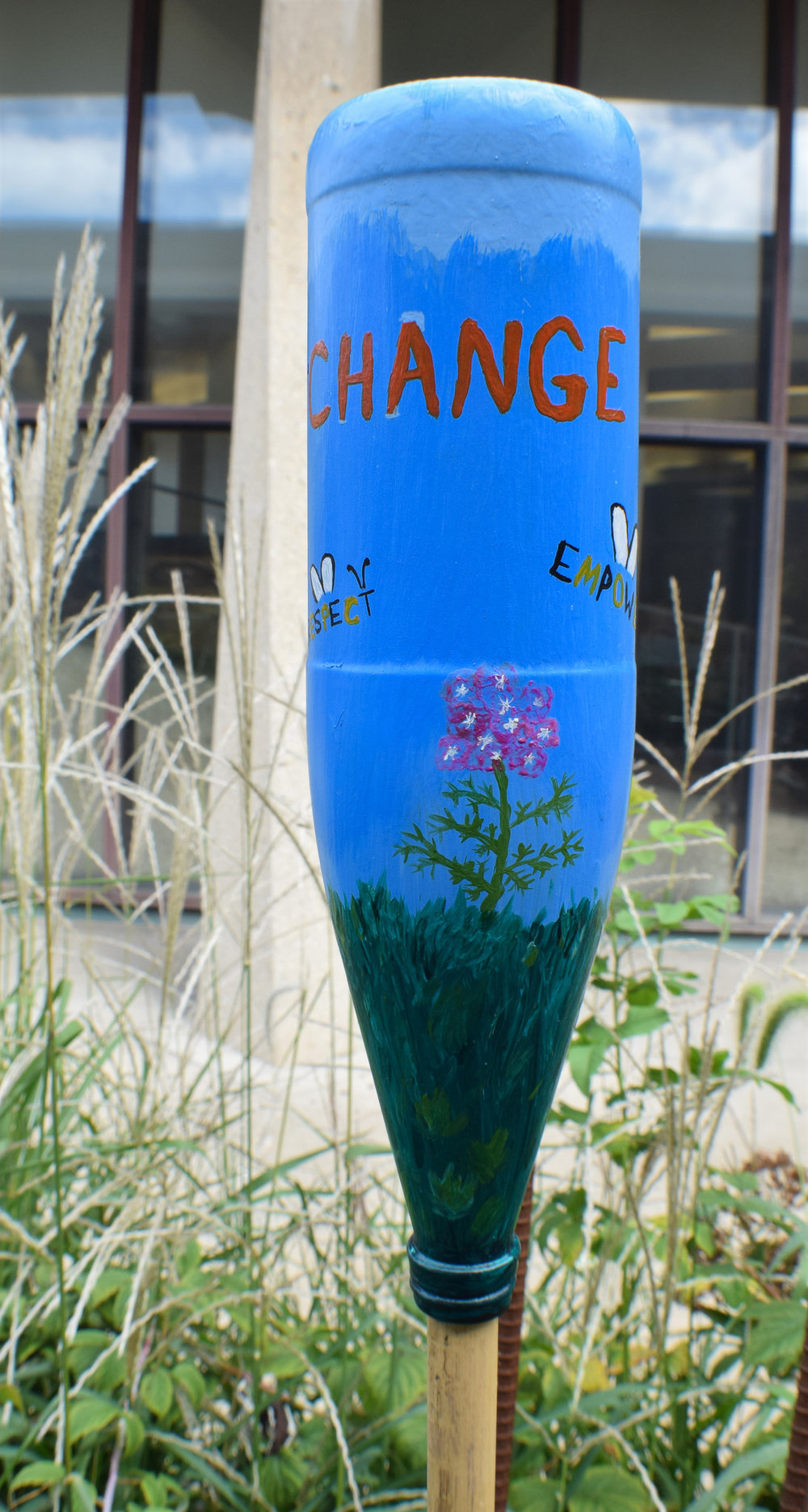 "Abby's bottle that reads ""Bee the Change"""