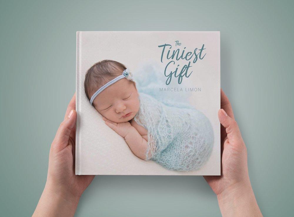 hands holding lemonshoots' coffee table newborn book