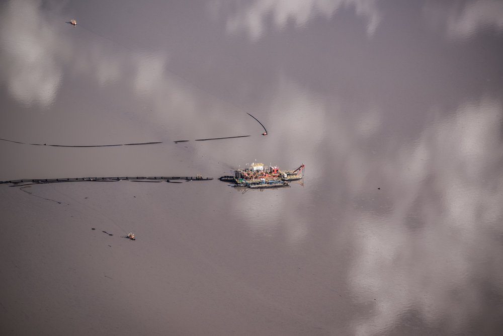 Dredge barge on a tailings pond, July 2016.