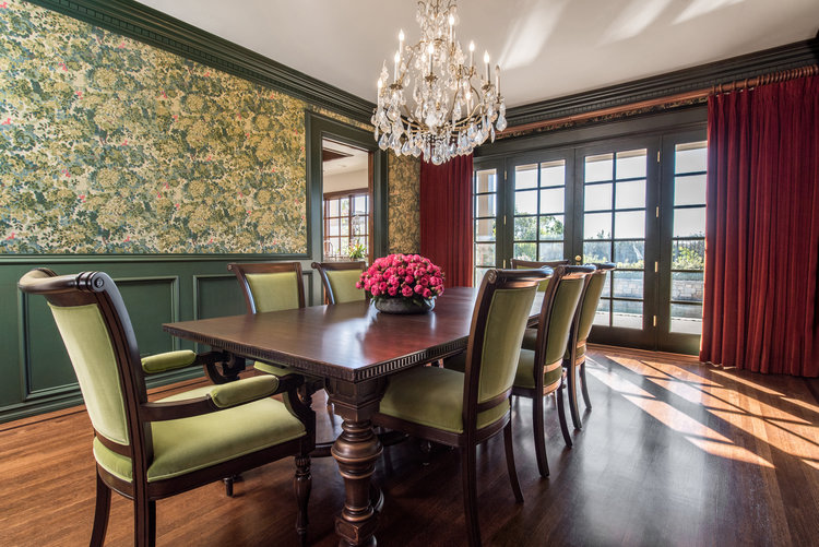 traditional home dining rooms. Luxurious tapestry in rich shades of forest green  chartreuse and burgundy adorn the walls this Pacific Palisades dining room Cotton velvet draperies Sarah Barnard Design Traditional Home Tapestry Dining Room